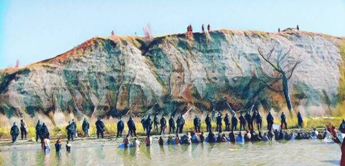 Cops fire on water protectors attempting to cross river to sacred site at Standing Rock.
