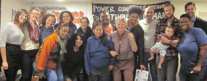 Participants in the Oct. 23 discussion, with one holding out the WWP campaign program.