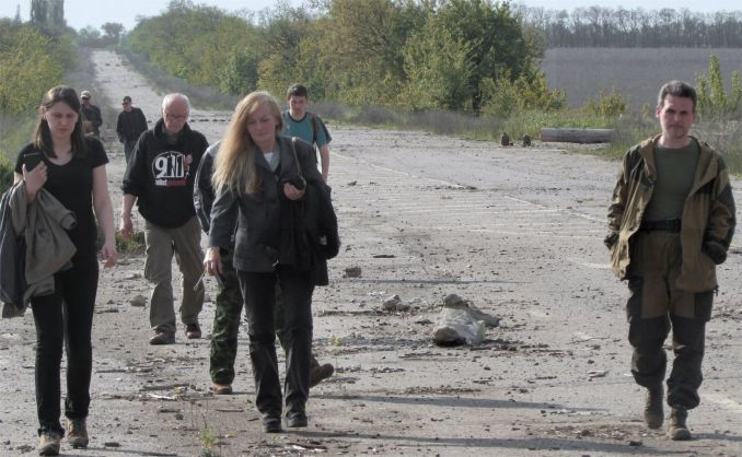 Ghost Brigade Commander Alexey Markov (right) gives international visitors a tour of the front line near Kirovsk, LPR.