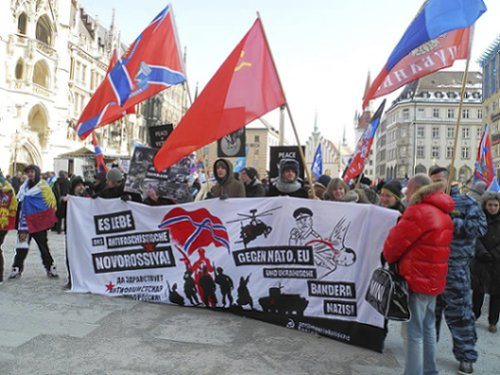 Anti-fascists protest war against Novorossiya by Ukraine and Western powers outside the Munich Security Conference, Feb. 7.Photo: Antiimperialistische Aktion