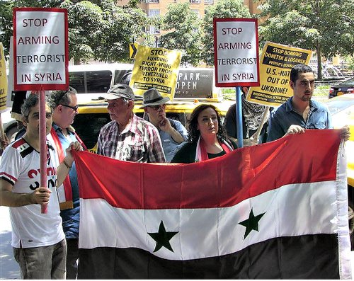 Some of the protesters, holding Syrian flag, June 13.WW photo: Greg Butterfield