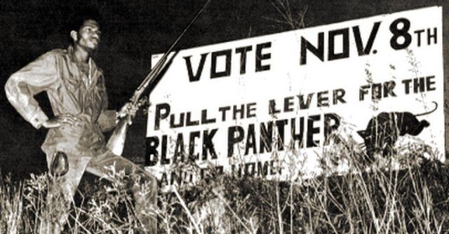 Election night in 1966 as armed self-defense guards protect Black voters for the Lowndes Co., Alabama, Freedom Democratic Party. The Black Panther was its ballot symbol.
