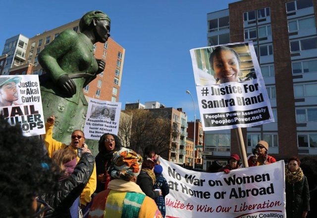 Celebrating International Women's Day in Harlem, N.Y. at a statue of Harriet Tubman, the amazing Civil War hero who helped hundreds escape slavery. They then marched to spotlight the many issues women face today.WW photo: Brenda Ryan
