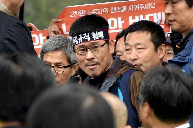 Han Sang-Gyun, the head of the Korean Confederation of Trade Unions (KCTU), surrenders voluntarily to the police in Seoul, Dec. 10.