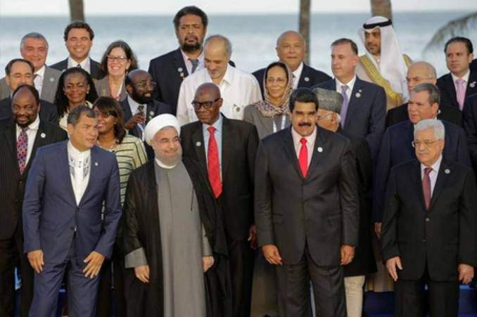 (bottom L-R) Ecuador's President Rafael Correa, Iranian President Hassan Rouhani, Venezuela's President Nicolas Maduro, Palestinian President Mahmoud Abbas and other presidents, leaders and heads of delegations pose for a photo during the 17th Non-Aligned Summit in Porlamar, Venezuela, September 17, 2016.