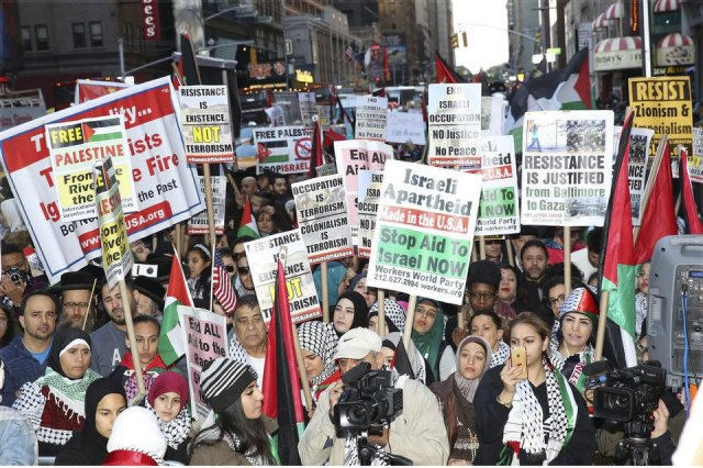 An estimated 2,000 Palestinians and their supporters rallied in New York's Times Square Oct. 18 on three days notice and then marched passed by a small Zionist gathering.Photo: NY4Palestine