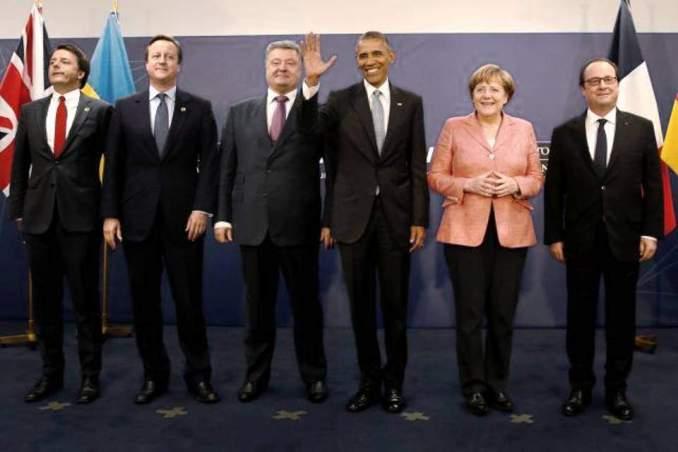Italy's Prime Minister Matteo Renzi (L-R), Britain's Prime Minister David Cameron, Ukraine's President Petro Poroshenko, U.S. President Barack Obama, Germany's Chancellor Angela Merkel and France's President Francois Hollande stand for a photograph after their meeting.