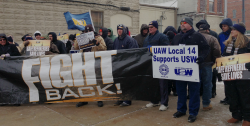 Workers march in Findlay, Ohio, home of Marathon, on Feb. 24.WW photo: Martha Grevatt