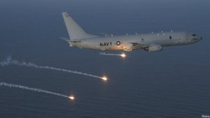 U.S. Navy's P-8 Poseidon surveillance jet launches flares over the Pacific.