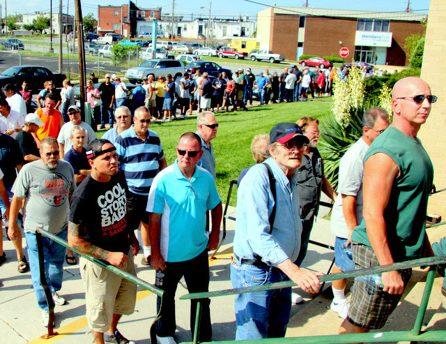 Steelworkers line up outside the USW union hall on Aug. 20, 2012 to learn that they no longer have jobs at Sparrows Point.