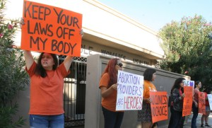 People protest in front of the Whole Women's Health clinic Saturday, October 4, 2014, in McAllen, Texas.