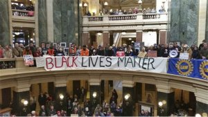 Black Lives Matter activists stand with unions in Madison in February.