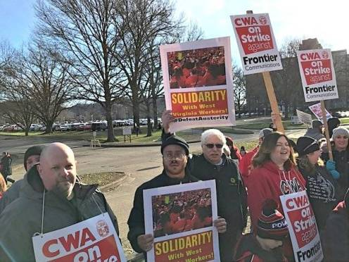Mond Sankara and David Sole, from a WWP-Detroit delegation, join CWA picket line at Frontier in Charleston, W.Va., March 5.