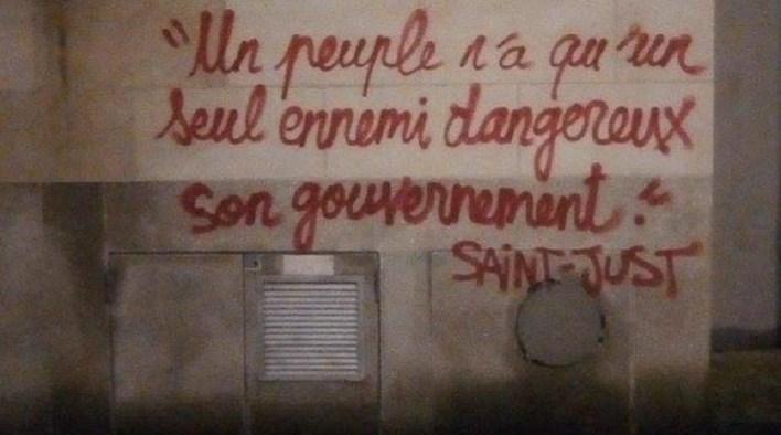 france revolt slogan on wall of paris