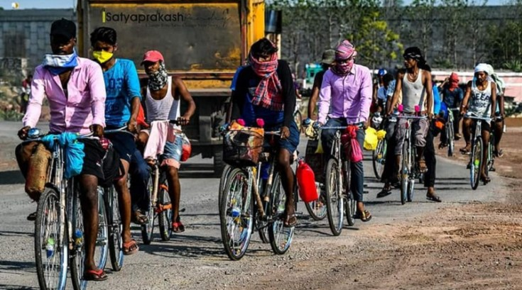 workers on cycle