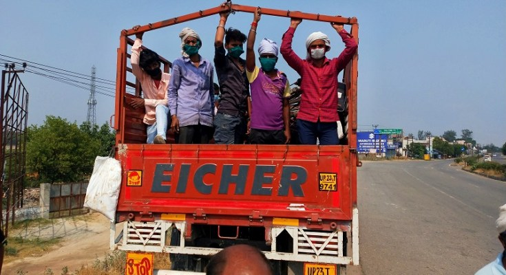 workers rides on truck in up