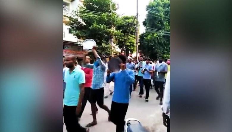 unemployed youth beat utensils