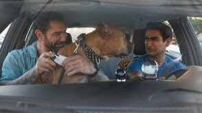 """Dave Bautista as Vic, Pico the Pibble, and Kumail Nanjiani as Stu in """"Stuber""""."""