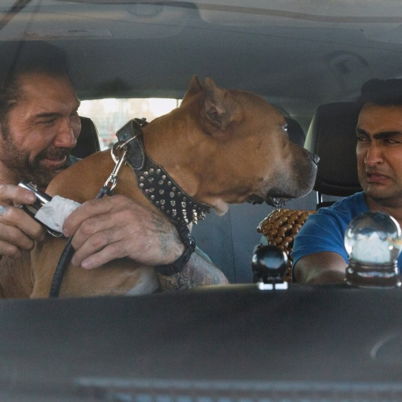 "Dave Bautista as Vic, Pico the Pibble, and Kumail Nanjiani as Stu in ""Stuber""."