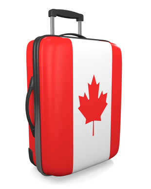 Canada vacation destination concept of a flag painted travel suitcase