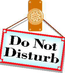 A Do Not Disturb notice hanging on a door handle