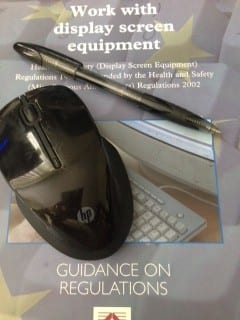 A mouse and a black pen resting on the cover of the Display Screen Equipment Guidance Book