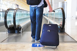 bigstock-Traveler-with-a-bag-at-the-spe-26609903