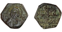 Multicultural coin of King Roger II. The date on this coin is written in early Arabic numerals, introduced from India during the Arab conquests, while Christ is shown on the reverse.