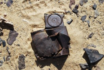 Around the former campfires were broken-up biscuit boxes and ration tins.