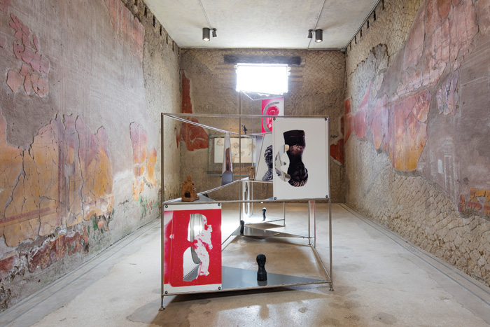 Contemporary art installation in room with Roman wall paintings in House of the Beautiful Courtyard, Pompeii