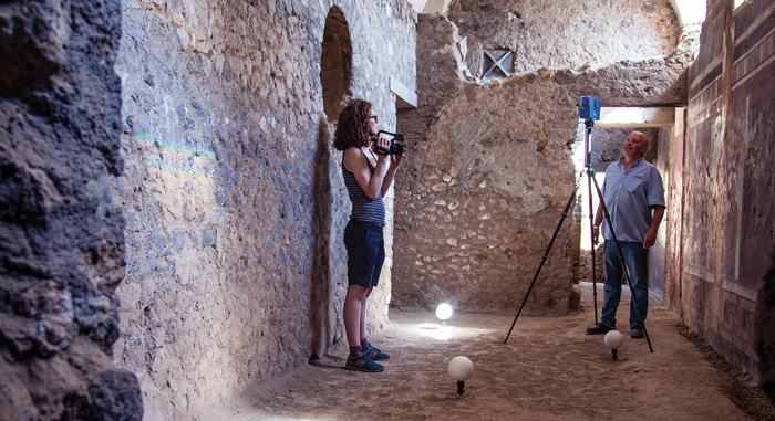 Two archaeologists scan Roman room