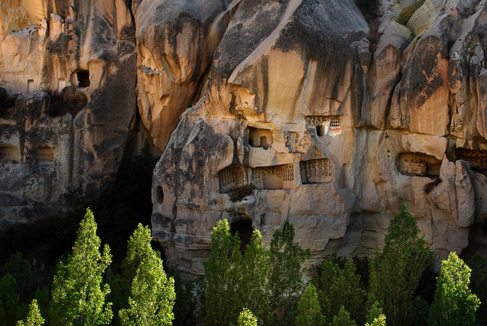 Small dwellings cut into the rock face