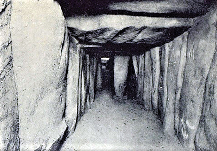 archival black and white photo showing the inside of the dolmen