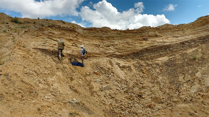Geologists take samples at a site