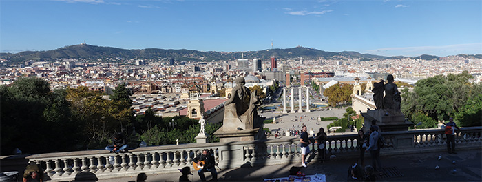 Panorama of the modern city of Barcelona, with mountains in the background
