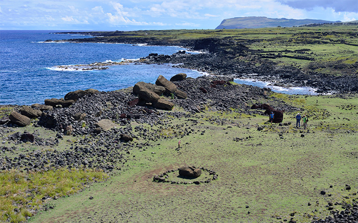 The shoreline with a small inlet and fallen moai