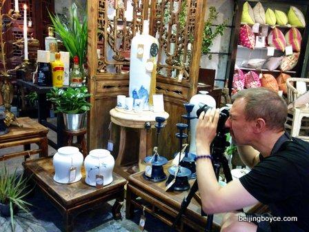 pop-up beijing glenn schuitman taking photos of baijiu bottles.jpg