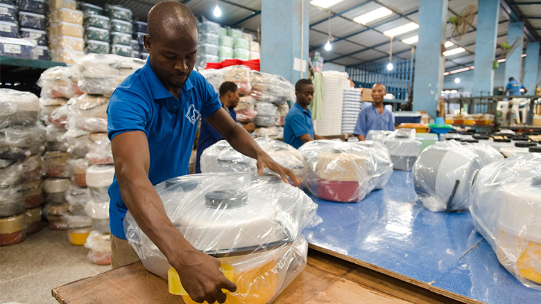 Factory workers package products at Decorplast, a manufacturer and regional exporter of injection-moulded plastic goods in Accra, Ghana