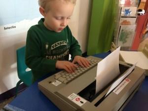 Child at typewriter