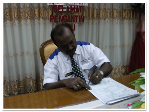 marriage-registrar-signing-papers