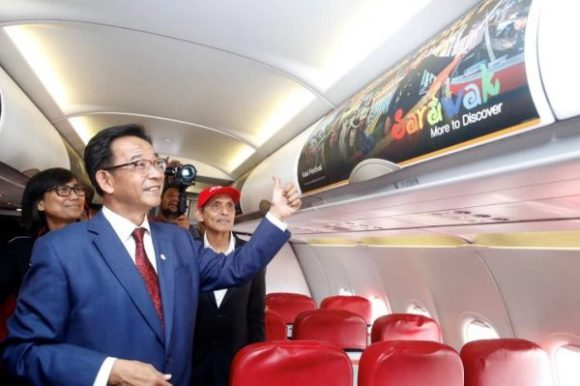 Minister thumb up sarawak tourism board air asia cabin ad panel