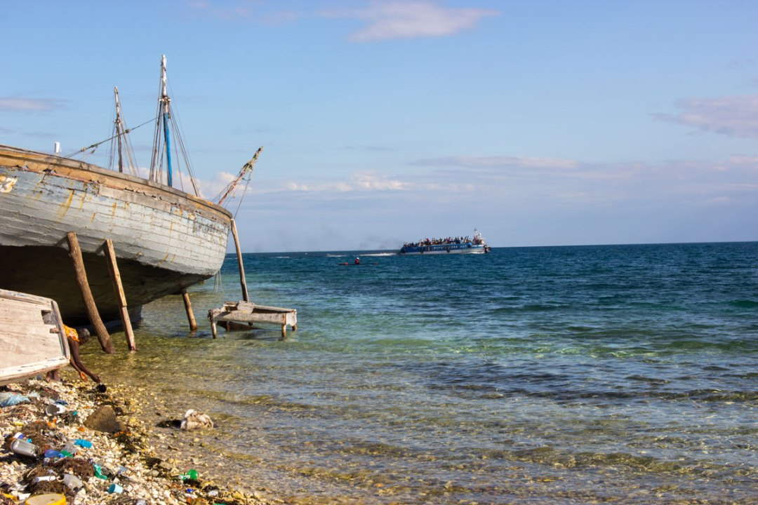A ferry crosses the sea from La Gonave to the Haitian mainland