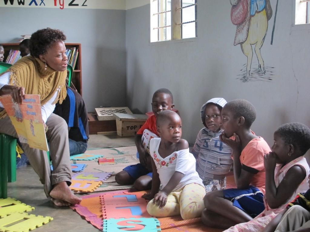 A librarian leads a reading activity in Bonna Baana, Uganda