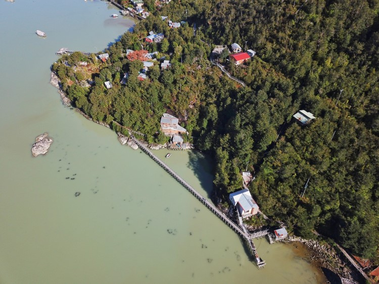 Caleta Tortel and the village's unique wooden walkways from the air in Chilean Patagonia.