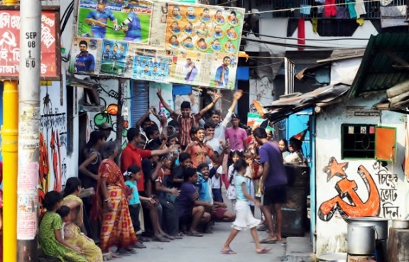 A tea stall hosting the TV viewing of the cricket match to a gathered crowd of the villagers