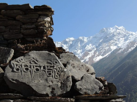 Hand-Carved Prayer Stone with Mountains in the Background