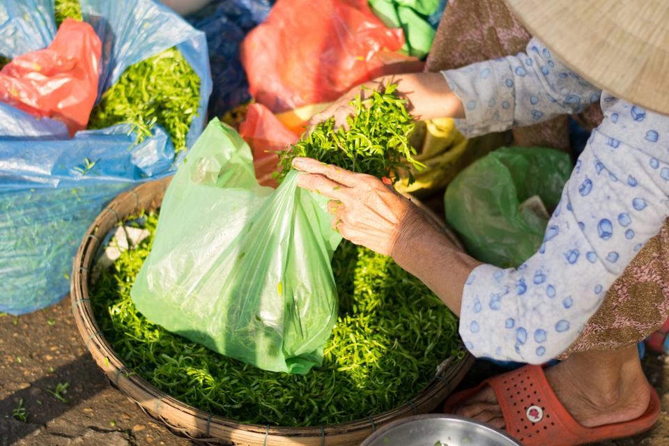 Elderly hands bagging vegetables