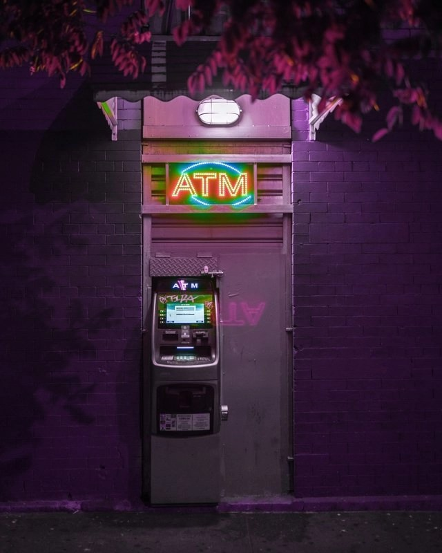 ATM machine in purple where you can get cash when you're making money while traveling