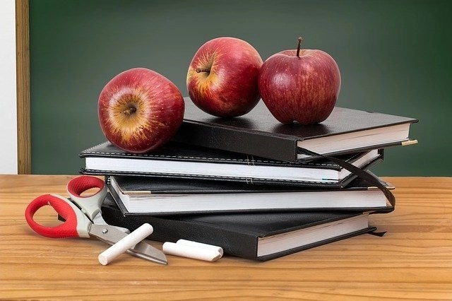 Books and apples for freelance teachers