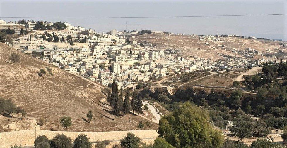 Buildings nestled into a mountain in Jerusalem, Israel